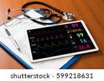 vital sign monitor in tablet pc ... | Shutterstock . vector #599218631