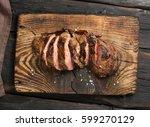 grilled steak on cutting board... | Shutterstock . vector #599270129