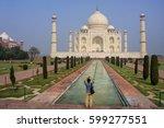 tourist photographing taj mahal ... | Shutterstock . vector #599277551