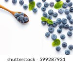 blueberries isolated on white... | Shutterstock . vector #599287931