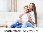 delighted mother and daughter... | Shutterstock . vector #599290871