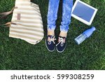 feet of a young girl on a... | Shutterstock . vector #599308259