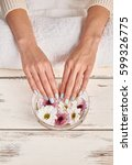 well manicured nails in spa.... | Shutterstock . vector #599326775