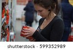 woman buys coffee in a... | Shutterstock . vector #599352989