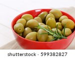 bowl of green olives with fresh ... | Shutterstock . vector #599382827