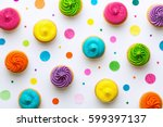 Colorful Cupcakes On A White...
