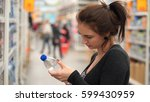 woman buys mineral water in... | Shutterstock . vector #599430959