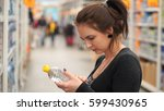woman buys mineral water in... | Shutterstock . vector #599430965