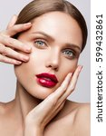 beautiful young model with red... | Shutterstock . vector #599432861