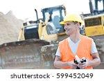 smiling supervisor looking away ... | Shutterstock . vector #599452049