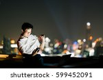asian man celebrate with... | Shutterstock . vector #599452091