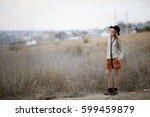 sad girl with long beautiful... | Shutterstock . vector #599459879