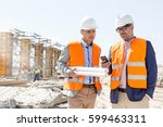 male engineers using mobile... | Shutterstock . vector #599463311
