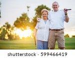 portrait of happy senior couple ... | Shutterstock . vector #599466419