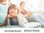 mother and daughter sitting on... | Shutterstock . vector #599475905