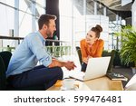 two business partners meeting... | Shutterstock . vector #599476481