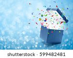 confetti popping out from blue... | Shutterstock . vector #599482481