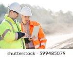 supervisors using laptop at... | Shutterstock . vector #599485079