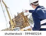 rear view of architect holding... | Shutterstock . vector #599485214