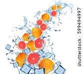 water splash with grapefruits... | Shutterstock . vector #599494997