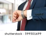 businessman  holding leather... | Shutterstock . vector #599501699