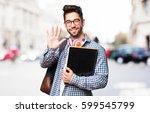 student man holding a book | Shutterstock . vector #599545799