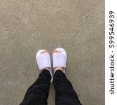 woman wearing white slippers... | Shutterstock . vector #599546939