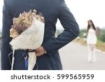 man hiding behind a bouquet of... | Shutterstock . vector #599565959