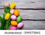 easter eggs with tulips top view   Shutterstock . vector #599575841