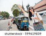 hailing a tuk tuk taxi car on... | Shutterstock . vector #599619839