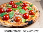 tasty pizza on a the table | Shutterstock . vector #599624399