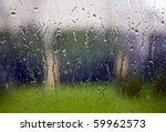View through the window to garden of house, raining - stock photo