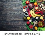 vegetables and fruits on a dark ... | Shutterstock . vector #599651741