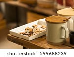 white ceramic mug with wood... | Shutterstock . vector #599688239