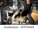 motor oil pouring  oil change | Shutterstock . vector #599704469