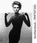 studio fashion portrait of... | Shutterstock . vector #599707181