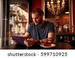 handsome young guy sitting in a ... | Shutterstock . vector #599710925