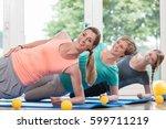 women doing exercises for... | Shutterstock . vector #599711219
