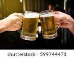 drinking beer to celebrate... | Shutterstock . vector #599744471