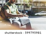 man with yellow backpack... | Shutterstock . vector #599795981