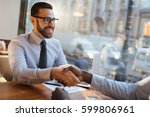 successful man shaking hand of... | Shutterstock . vector #599806961