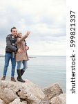 smiling young couple standing... | Shutterstock . vector #599821337