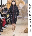 Small photo of NEW YORK, NY - FEBRUARY 11, 2017: Iana Godnia walks the runway at the Lacoste Fall Winter 2017 fashion show during New York Fashion Week at the Spring Studios