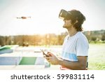 bearded man using a drone with... | Shutterstock . vector #599831114