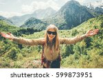 young woman traveler hiking in... | Shutterstock . vector #599873951