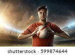 soccer player in red uniform | Shutterstock . vector #599874644