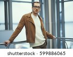 the guy at the business center | Shutterstock . vector #599886065
