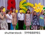 Small photo of ODESSA, UKRAINE - March 8, 2017: Children at concert in primary school. Skit. Children's theatrical creativity, amateur performance in kindergarten congratulate mothers on Women's Day, Mother's Day