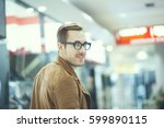 a young guy walks to the shops | Shutterstock . vector #599890115