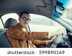 driving instructor driving the... | Shutterstock . vector #599890169